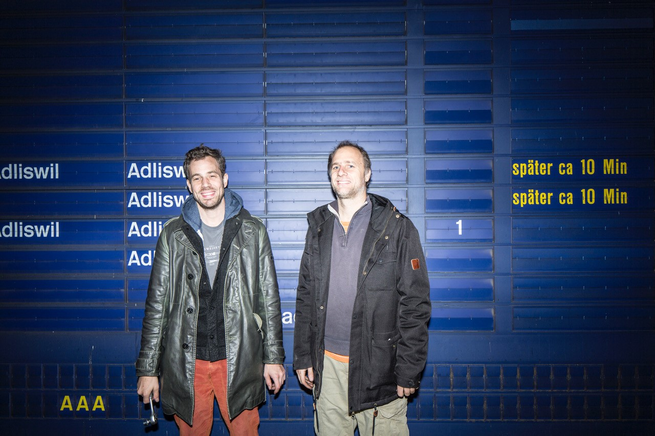 Andreas and Sidi in front of the dismantled SBB display from the Zürich main station. Image: Matteo Fieni